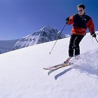 SKIING. Rob Schumacher skis Challenger lift at Big Sky Resort, Montana. Lone Mountain bkg.