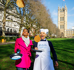 © Licensed to London News Pictures. 28/02/2017. London, UK. BBC Breakfast's NAGA MUNCHETTY and Labour MP CLIVE LEWIS practise their pancake flips at the annual Rehab Parliamentary Pancake Race outside the Parliament on Shrove Tuesday, 28 February 2017. Photo credit: Tolga Akmen/LNP