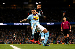 Manchester City's Nicolas Otamendi (left) and West Ham United's Manuel Lanzini (right) battle for the ball during the Premier League match at the Etihad Stadium, Manchester.