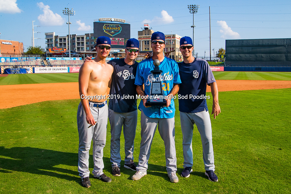 Amarillo Sod Poodles pitcher Evan Miller (17), Amarillo Sod Poodles pitcher Aaron Leasher (32), Amarillo Sod Poodles pitcher Elliot Ashbeck (28), and Amarillo Sod Poodles pitcher MacKenzie Gore (13) poses with the trophy after the Sod Poodles won against the Tulsa Drillers during the Texas League Championship on Sunday, Sept. 15, 2019, at OneOK Field in Tulsa, Oklahoma. [Photo by John Moore/Amarillo Sod Poodles]