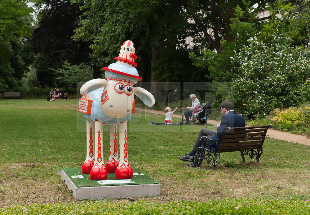 © Licensed to London News Pictures. 06/07/2015. Bristol, UK.  SHAUN THE SHEEP, 'The Shear Speed Helter Skelter' designed by Gav Strange.  The Shaun in the City trail starts today with 70 5ft tall Shaun the Sheep sculptures originally devised by Aardman Animations with these sculptures decorated by various artists.  The Shaun trail happened in London in the spring, and the Bristol Trail lasts till 31 August.  At the end of September all 120 Shaun sculptures will be viewable together in Covent Garden.  All sculptures will then go to auction on 8th October, with proceeds from the Bristol sculptures benefitting The Grand Appeal which funds pioneering medical equipment, facilities, and comforts for patients at Bristol Children's Hospital. Proceeds from the London sculptures will benefit Wallace & Gromit's Children's Charity supporting children's hospitals and hospices throughout the UK. Photo credit : Simon Chapman/LNP