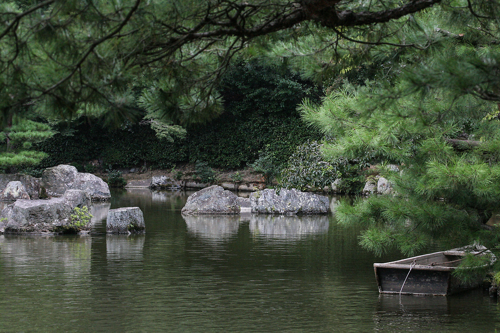 View of a tranquil Japanese pond with row boat
