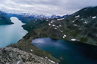 Norway, Jotunheimen. Hiking the famous Besseggen mountain ridge on the northern side of the Gjende Lake.