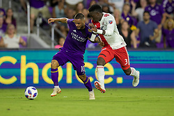 August 4, 2018 - Orlando, FL, U.S. - ORLANDO, FL - AUGUST 04: Orlando City midfielder Josue Colman (10) and New England Revolution defender Jalil Anibaba (3) go for the ball during the soccer match between the Orlando City Lions and the New England Revolution on August 4, 2018 at Orlando City Stadium in Orlando FL. (Photo by Joe Petro/Icon Sportswire) (Credit Image: © Joe Petro/Icon SMI via ZUMA Press)