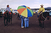 06 AUGUST 2000 - WILLIAMS, AZ: People in the rain at the 22nd Annual Cowpunchers' Reunion Rodeo in Williams, Arizona, Aug 6.  The Cowpunchers' Reunion Rodeo is held for working cowboys from the ranches in Arizona and the region. PHOTO BY JACK KURTZ