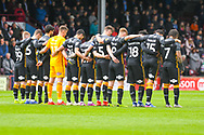Bradford City players observe a minute silence during the EFL Sky Bet League 1 match between Scunthorpe United and Bradford City at Glanford Park, Scunthorpe, England on 27 April 2019.