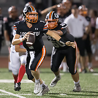(Photograph by Bill Gerth/ for SVCN/9/8/17)Los Gatos #7 Robert Nelson looks for a receiver vs San Benito in a preseason football game at Los Gatos High School, Los Gatos CA on 9/8/17. (San Benito 21 Los Gatos 20)