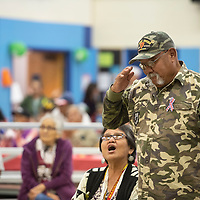 Jasper Walker, Marine Corps Vietnam veteran from St. Michaels stands to be acknowledged during the military branch shout outs at Chee Dodge Elementary School in Yahtahey at their 2018 Veterans Day Honor Celebration, Saturday, Nov. 10, 2018.