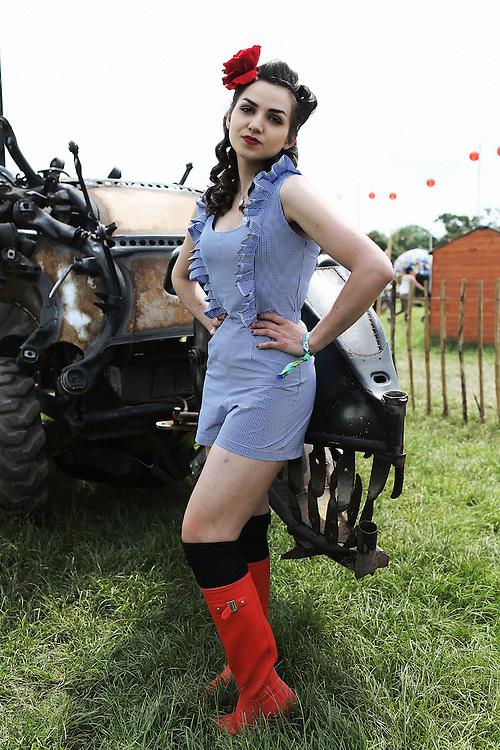 Steet Style fashion of girls in orange Hunter Wellies  from Glastonbury Festival in Somerset  on Thursday, 27 June 2013
