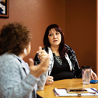 Tourism and Marketing Director for the city of Gallup, Jennifer Lazarz, right, talks with City Councilor Linda Garcia, left, on her project to have a city wide cleanup day.