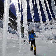 Peter Whittaker walks along a glacier high above Everest's Advanced Basecamp on an acclimatization day; Lhotse and the Lhotse Face are visible behind.