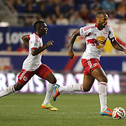 Thierry Henry, (right), New York Red Bulls, flanked by Lloyd Sam, in action during the New York Red Bulls Vs San Jose Earthquakes, Major League Soccer regular season match at Red Bull Arena, Harrison, New Jersey. USA. 19th July 2014. Photo Tim Clayton