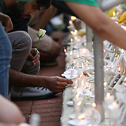 CHARLOTTE NC - MAY 1: Students lay candles and flowers at the steps of Kennedy Hall to honoring the victims of a shooting the day earlier on the University of North Carolina Charlotte campus in University City, Charlotte, NC on April 30, 2019.  (Logan Cyrus for AFP)