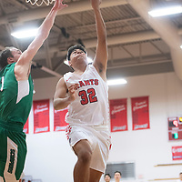 Grants Pirate Tyler Everhart (32) drives to the basket for a layup against Farmington during the Eddie Peña Classic Basketball Tournament in Grants Thursday.