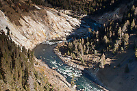 Chemicals from the hot water vents at Calcite Springs are slowly turning the cliff along the Yellowstone river to whitish, yellowish pulp. Found near the Tower-Roosevelt Junction.  Yellowstone National Park, Wyoming, USA.