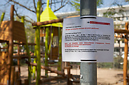 Coronavirus / Covid 19 outbreak, April 8th. 2020. Closed children's playground at the street Theodor-Heuss-Ring, Cologne, Germany<br /> <br /> Coronavirus / Covid 19 Krise, 8. April 2020. Gesperrter Kinderspielplatz am Theodor-Heuss-Ring,  Koeln, Deutschland.