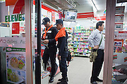 "May 12 - BANGKOK, THAILAND: Thai police shop in a 7/11 before deploying on the front line between security forces and protesters near Sala Daeng intersection. The Thai government said Wednesday that time has run out for ""Red Shirt"" protesters in Ratchaprasong and Sala Daeng intersections in Bangkok and that a crackdown could come at any time. As news of the anticipated crackdown spread, Red Shirt protesters continued with an almost festive mood at their main stage but many of the sleeping areas around the protest site appeared to be empty. No official estimates on crowd size are available.  Photo by Jack Kurtz"