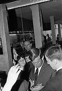 Singer Val Doonican opens new Silk Department at Boyers Stores, North Earl Street, Dublin. Val Doonican signing autographs.<br /> 25.05.1967