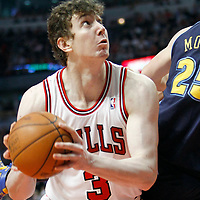 26 March 2012: Chicago Bulls center Omer Asik (3) eyes the basket during the Denver Nuggets 108-91 victory over the Chicago Bulls at the United Center, Chicago, Illinois, USA. NOTE TO USER: User expressly acknowledges and agrees that, by downloading and or using this photograph, User is consenting to the terms and conditions of the Getty Images License Agreement. Mandatory Credit: 2012 NBAE (Photo by Chris Elise/NBAE via Getty Images)