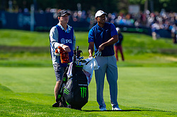 May 16, 2019 - Farmingdale, NY, U.S. - FARMINGDALE, NY - MAY 16: Tiger Woods of the United States pulls a club from his bag as he prepares to play a shot on the 12th hole during Round One of the PGA Championship Tournament on May 16, 2019, at Bethpage State Park in Farmingdale, NY (Photo by John Jones/Icon Sportswire) (Credit Image: © John Jones/Icon SMI via ZUMA Press)