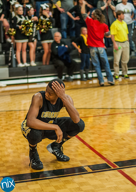 Concord's Ty-Shon Alexander (1) takes a moment to himself after the Spiders lost to Pisgah in the third round of the NCHSAA 3A State Basketball Championships Friday night at Pisgah High School in Canton. Pisgah defeated the Spiders 66-64.