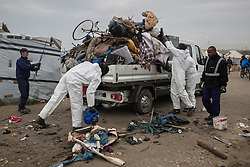 © Licensed to London News Pictures . 24/10/2016 . Calais , France . Clearance of the Jungle migrant camp in Calais , Northern France , underway , on the day of a planned eviction and start of the destruction of the camp . Photo credit: Joel Goodman/LNP