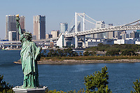 """The Rainbow Bridge was designed to allow ships to safely pass under the bridge, but as it is close to Haneda airport it could not be built over a certain height to allow for safe airline paths. It is a two storey bridge with monorail train on one level and an expressway on another level. It is lit up at night, along with the Statue of LIberty replica and Tokyo Tower in the distance, giving it a """"romantic"""" look."""