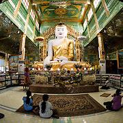Prayer hall of Soon Oo Pon Nya Shin Pagoda, Sagaing, Myanmar. Sitting on top of Nga-pha Hill, Soon Oo Pon Nya Shin Pagoda is one of multiple pagodas and temples in the religious district of Sagaing, near Mandalay. The original pagoda dates to 674.