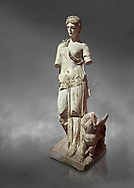 Roman statue of Nemesis. Marble. Perge. 2nd century AD. Inv no 3310 . Antalya Archaeology Museum; Turkey.  Against a grey background .<br /> <br /> If you prefer to buy from our ALAMY STOCK LIBRARY page at https://www.alamy.com/portfolio/paul-williams-funkystock/greco-roman-sculptures.html . Type -    Antalya     - into LOWER SEARCH WITHIN GALLERY box - Refine search by adding a subject, place, background colour, museum etc.<br /> <br /> Visit our ROMAN WORLD PHOTO COLLECTIONS for more photos to download or buy as wall art prints https://funkystock.photoshelter.com/gallery-collection/The-Romans-Art-Artefacts-Antiquities-Historic-Sites-Pictures-Images/C0000r2uLJJo9_s0