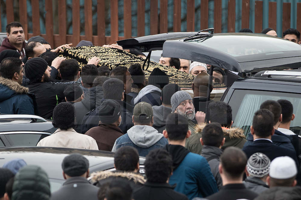 © Licensed to London News Pictures. 06/01/2017. Huddersfield, UK. The coffin is carried from the mosque in to the hearse . The funeral of Yassar Yaqub at Jamia Bilal Mosque in Huddersfield, West Yorkshire. Yaqub, 28, from Huddersfield, was shot dead in a car stopped near junction 24 of the M62 as part of a planned police operation. Photo credit: Joel Goodman/LNP
