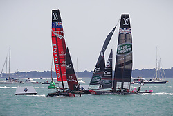 © Licensed to London News Pictures. 25/07/2015. Portsmouth, UK. Team Land Rover BAR (Ben Ainslie Racing) and Fly Emirates Team New Zealand fighting it out for first place in the first leg of the America's Cup World Series in Portsmouth this weekend. Today, 25th July 2015, is the first race day in which British Olympic sailing legend, Sir Ben Ainslie, will be leading his all-British team, Land Rover BAR, against other teams in a battle to qualify for a place in the two team America's Cup final, to be held in Bermuda in 2017.  Photo credit : Rob Arnold/LNP