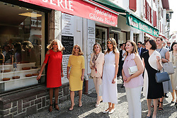 Brigitte Macron, wife of French President Emmanuel Macron, U.S. First Lady Melania Trump, Akie Abe, wife of Japan's Prime Minister Shinzo Abe, Chile's First Lady Cecilia Morel, Jenny Morrison, wife of Australia's Prime Minister Scott Morrison, and Malgorzata Tusk, wife of European Council President Donald Tusk pose in front of a bakery during a visit on traditional Basque culture in Espelette, near Biarritz as part of the G7 summit, France.August 25, 2019. Photo by Thibaud Moritz/ABACAPRESS.COM