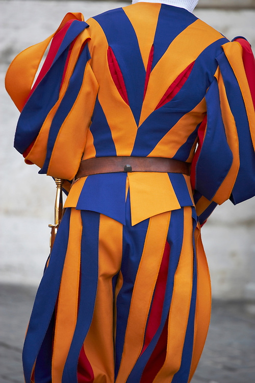 Rear view of a Pontifical Swiss guard who protect the Pope and its area of operation is in the Vatican. One of the most outstanding traditions of the Vatican