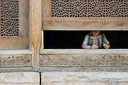 A girl at the window of The Arg (Citadel) of Karim Khan, Shiraz, Iran