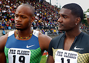 Justin Gatlin (USA), right, and Asafa Powell (JAM) pose after placing first and second in the 100mduring the Prefontaine Classic, Sunday, May 28, 2006, in Eugene, Ore.
