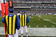 PHILADELPHIA - DECEMBER 30: Line Referee's stand on the sideline before a play during the Philadelphia Eagles game against the Buffalo Bills on December 30, 2007 at Lincoln Financial Field in Philadelphia, Pennsylvania. The Eagles won 17-9.