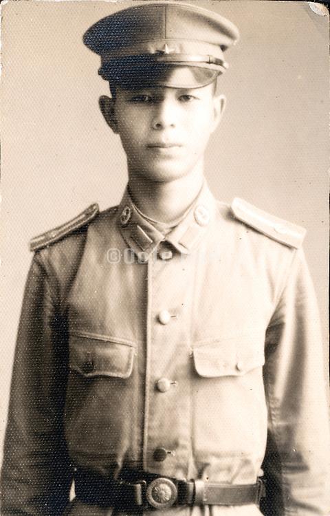 portrait young adult boy in uniform Japan ca 1940s