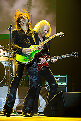 © Licensed to London News Pictures . 15/12/2015 . Manchester , UK . ROBBIE CRANE and  SCOTT GORHAM . Black Star Riders perform at the Manchester Arena . Photo credit : LNP