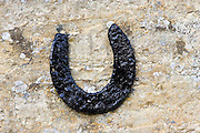 Horseshoe on a Cotswold stone wall farmhouse, Oxfordshire, United Kingdom