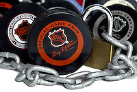 Photo Illustration of NHL ice hockey pucks locked up with chains. The NHL National Hockey League and NHLPA NHL Players Association undergoing talks of a new CBA labor agreement.