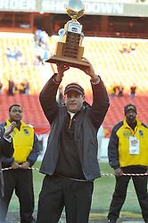 Nov 27, 2010; Kansas City, MO, USA; Missouri Tigers head coach Gary Pinkel holds high the Lamar Hunt Trophy after the Tigers defeated the Kansas Jayhawks 35-7 at Arrowhead Stadium. Mandatory Credit: Denny Medley-US PRESSWIRE