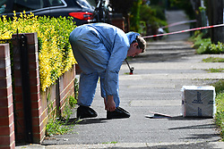 © Licensed to London News Pictures. 02/05/2020.  London UK:  Forensic officers in Upminster in Havering, East London seen in Kerry drive and surrounding areas after an 11 year old was shot at around 9.30 yesterday evening. He was rushed to hospital along with a male in his forties who suffered lacerations to the head , Photo credit: Steve Poston/LNP