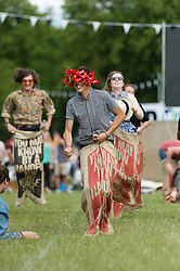 © Licensed to London News Pictures. 08/06/2014. London, UK.  Festival atmosphere at Field Day Festival 2014 - festival goers compete against each other in a sack race.  Field Day is an annual outdoor music festival which takes place in Victoria Park in London.    Photo credit : Richard Isaac/LNP