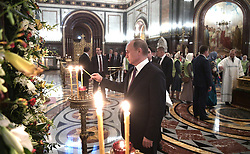 May 24, 2017 - Moscow, Russia - May 24, 2017. - Russia, Moscow. - Russian President Vladimir Putin visits the Christ the Savior Cathedral, where the ark with Saint Nicholas relics is placed. (Credit Image: © Russian Look via ZUMA Wire)