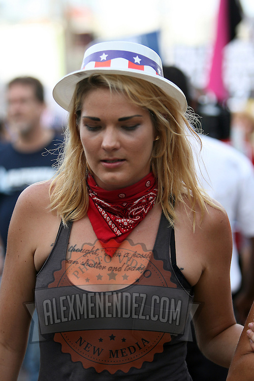 A female protester marches in a parade during the Republican National Convention in Tampa, Fla. on Wednesday, August 29, 2012. (AP Photo/Alex Menendez)