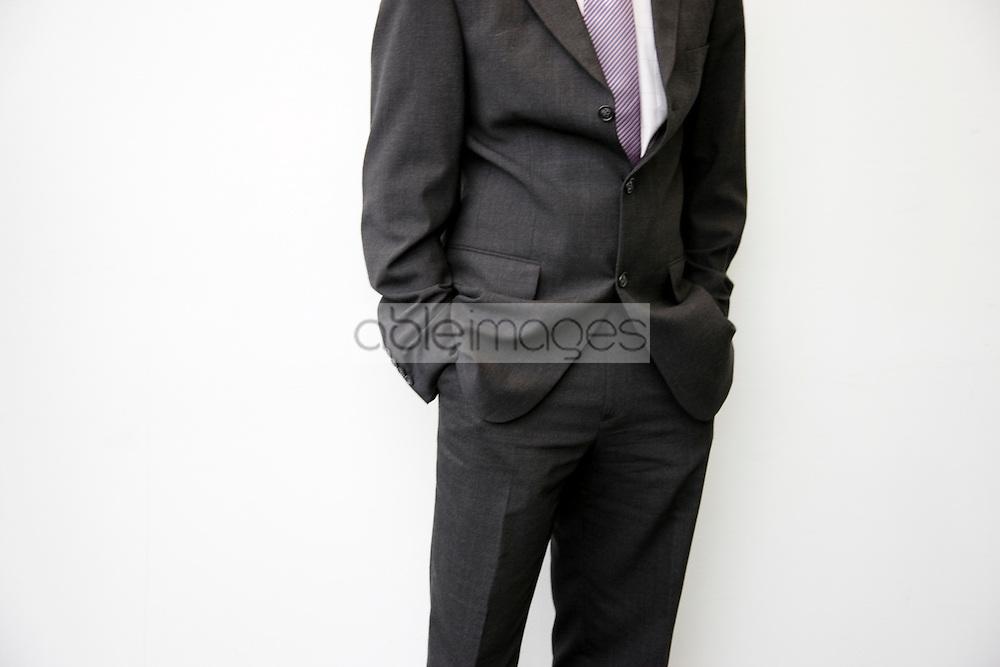 Portait of headless businessman with hands inside pocket