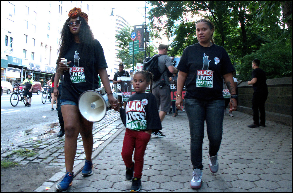 On August 12th, 2019, Angelique Negroni-Kearse (r) and her daughter march with Black Lives Matter New York from the Adam Clayton Powell Jr. State building to Trump Tower, remembering Eric Garner and protesting Officer Panteleo's continued employment with NYPD and Mayor De Balsio's failure to hold him to account for Eric Garner's death.<br /> <br /> Angelique Negroni-Kearse's husband, Andrew Kearse, died in police custody in 2017.