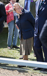 © Licensed to London News Pictures. 10/05/2017. Windsor, UK. Queen Elizabeth II looks at horses at the Royal Windsor Horse Show. The five day equestrian event takes place in the grounds of Windsor Castle. Photo credit: Peter Macdiarmid/LNP