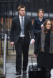© London News Pictures. 22/11/2011. London, UK.  Former Premier League footballer GARRY FLITCROFT (left) arriving at The Royal Courts of Justice today (22/11/2011) to give evidence at the Leveson Inquiry into press standards. The inquiry is being lead by Lord Justice Leveson and is looking into the culture, and practice of the UK press. The Leveson inquiry, which may take a year or more to complete, comes after The News of The World Newspaper was closed following a phone hacking scandal. Photo credit : Ben Cawthra/LNP