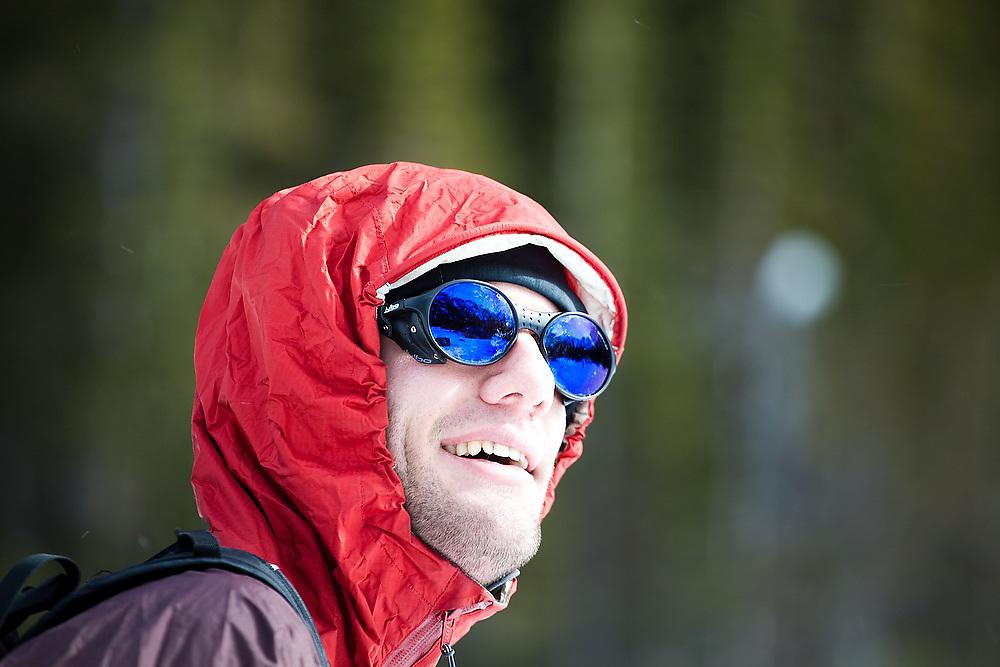 Obadiah Reid wears glacier glasses on a hike to Black Lake in Rocky Mountain National Park, Colorado.